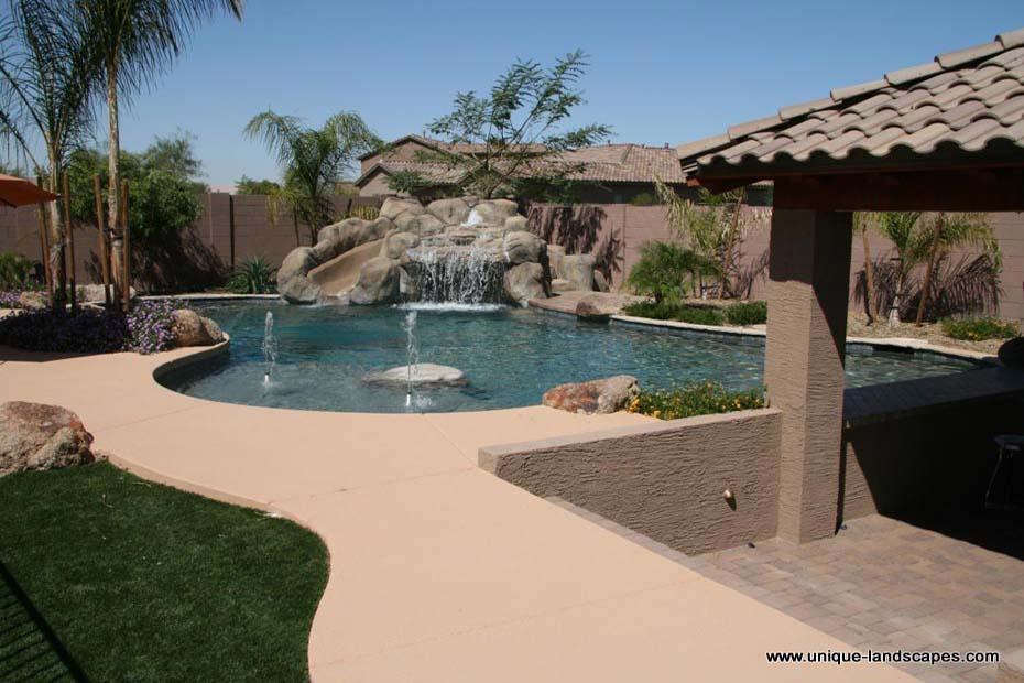 Pool Designs With Rock Slides 15 gorgeous swimming pool slides home design lover Rock Slide Into A Freeform Pool