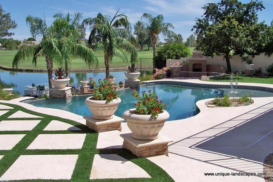 Phoenix freeform lagoon swimming pool spa design photo for Garden ideas around swimming pools