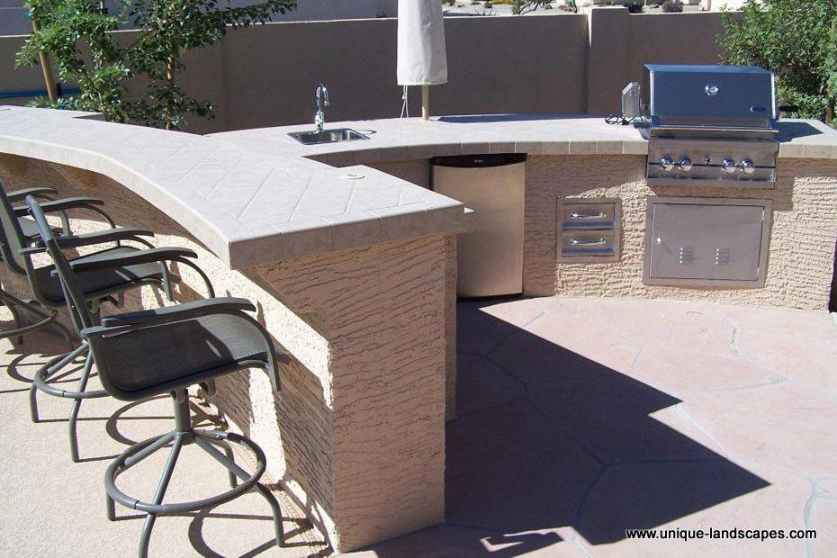 ... our ceramic tile countertops, umbrella sleeve, fridge, sink & grill